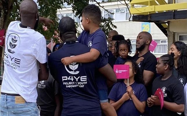 kids and adults wearing p4ye t-shirts