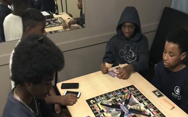 young boys playing a board game