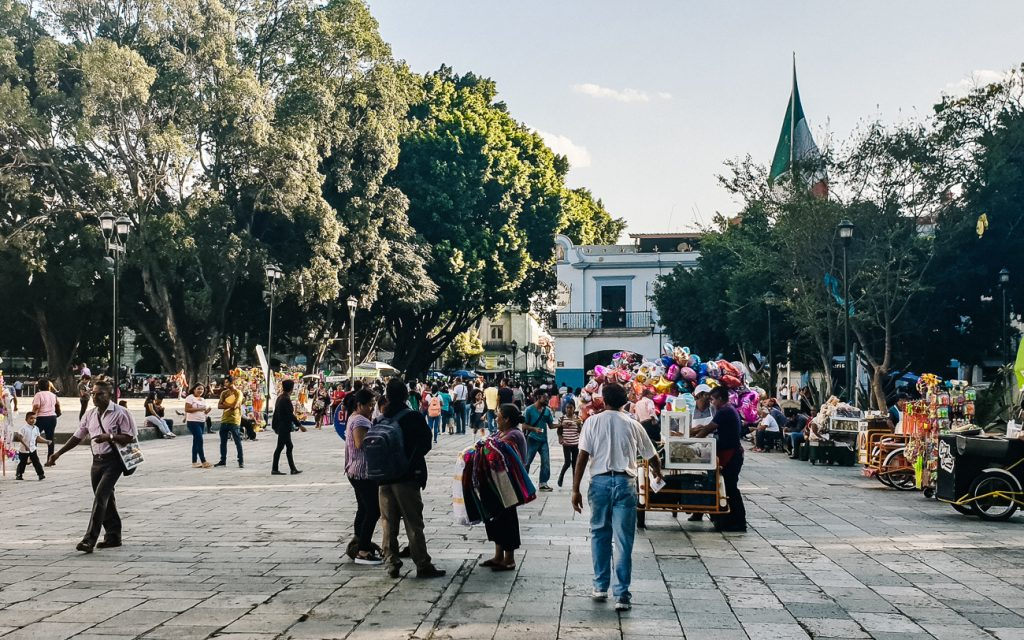 Local busy city square in Oaxaca Mexico, one of the cultural capitals of Mexico