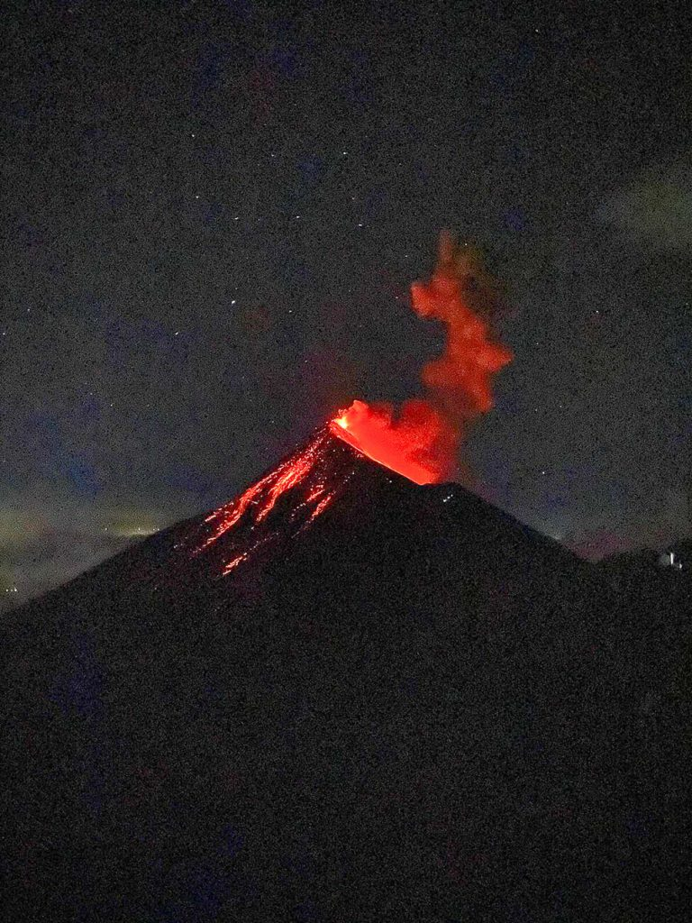 the erupting Fuego volcano with smoke and lava