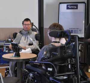 Mark Chapman and another electric wheelchair user in conversation