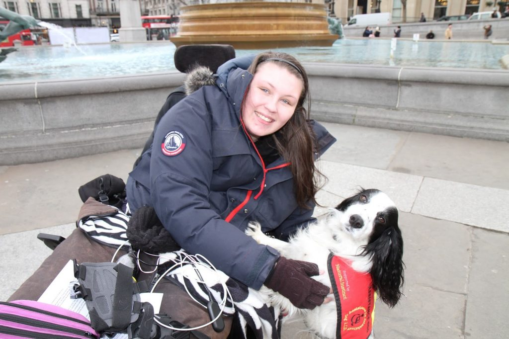 Lucy Watts with assistance dog Molly