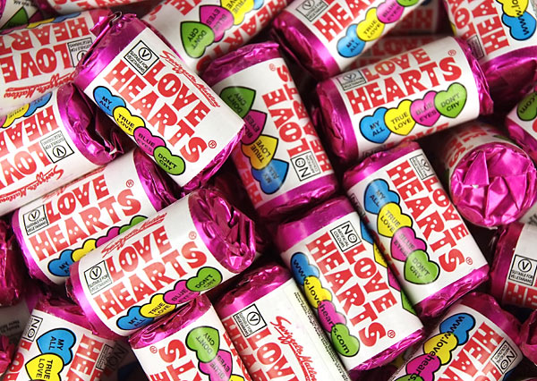 lots of packets of love heart sweets