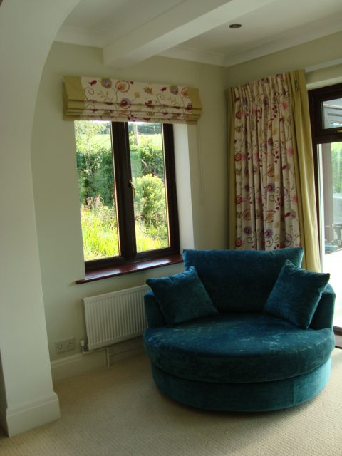 Roman Blinds and matching double pleated curtains