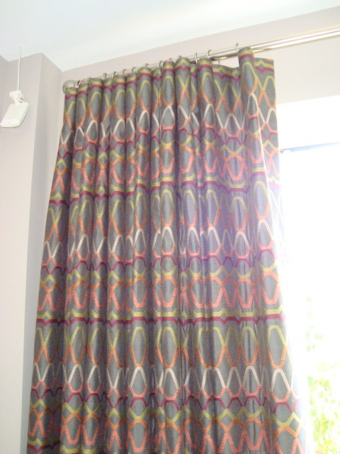 Custom fitted curtains on a metal curtain pole