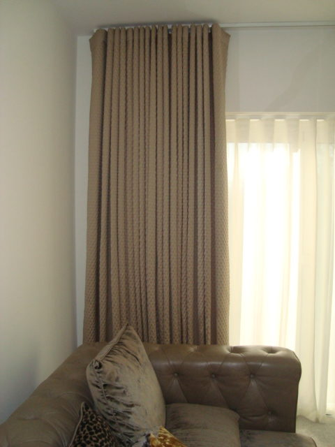 Wave Curtains, floor to ceiling height and a net curtain. Custom made.