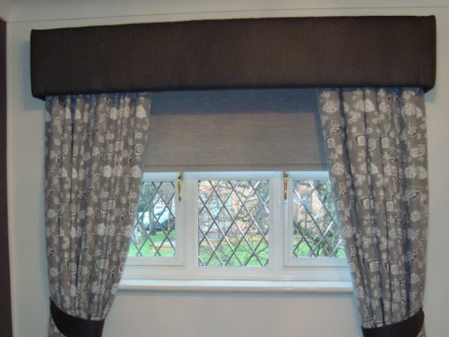 Roller blinds, eyelet curtains, tiebacks and a box pelmet