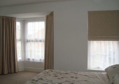Matching custom made curtains, roman blinds and nets.