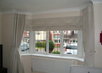 Cream curtains and Roman Shades