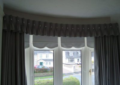 Triple Pinch pleats and roller blinds
