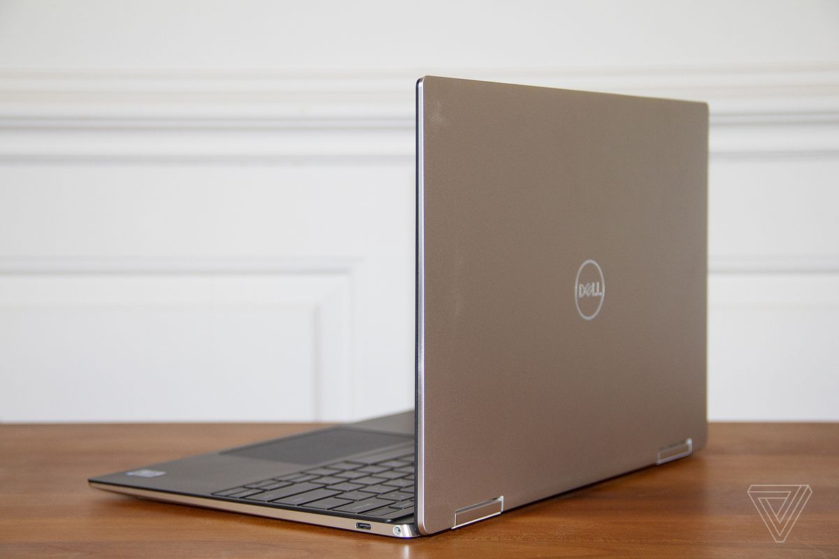 The Dell XPS 13 2-in-1 from the back, angled to the left.
