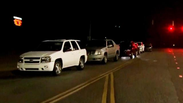Cars line up at 4:30 a.m. for drive-thru vaccine clinic
