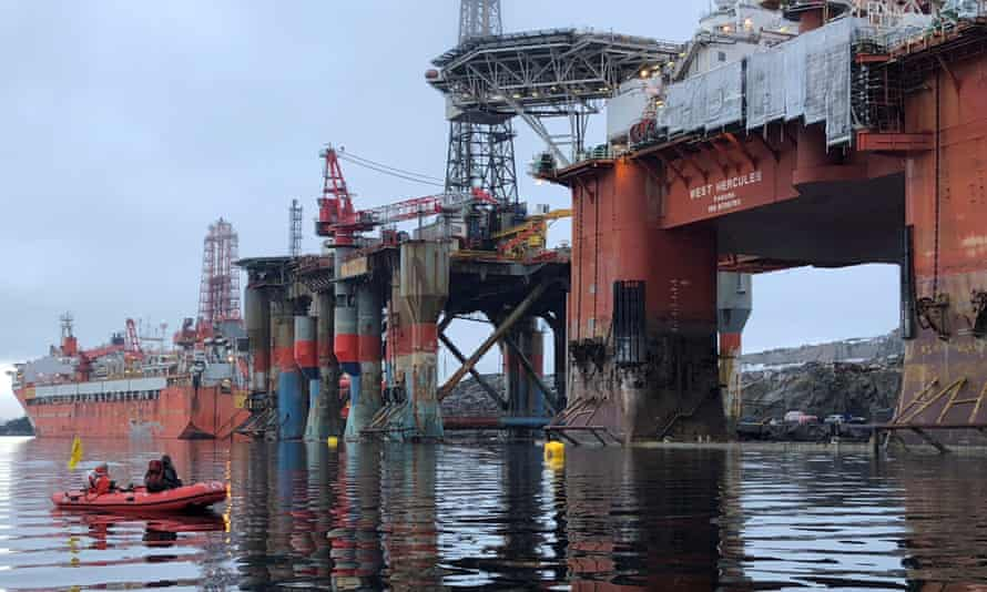 Greenpeace activists boarding an oil rig in a fjord off the West coast of Norway in 2018.