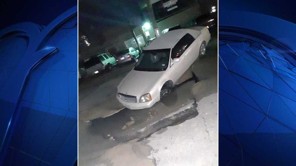 NBC 5 viewer Glen Clark emailed iSee@nbcdfw.com a picture of a car nearly swallowed by a sinkhole in Fort Worth.