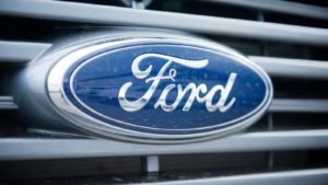 Ford (F) logo badge on grill of car