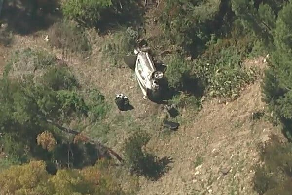 A vehicle rest on its side after a rollover accident involving golfer Tiger Woods along a road in the Rancho Palos Verdes.