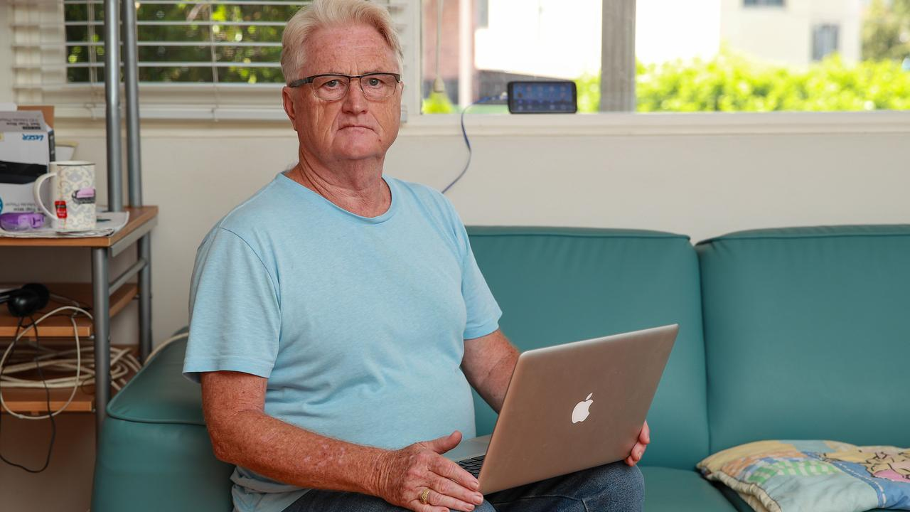 Gary Robinson, at home in Earlwood, Sydney, said he was forced to balance his mobile phone on a windowsill to access the internet after a halt on new NBN HFC connections. Picture: Justin Lloyd