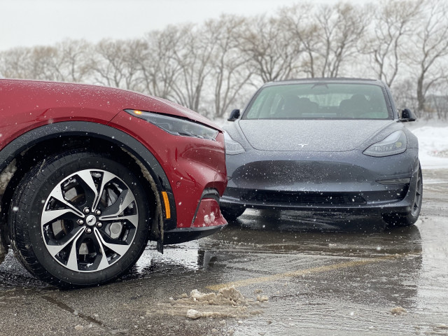 2021 Ford Mustang Mach-E, left, and 2021 Tesla Model 3, right