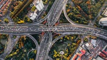 Bird's eye view of traffic across multiple motorways in Shanghai, China.