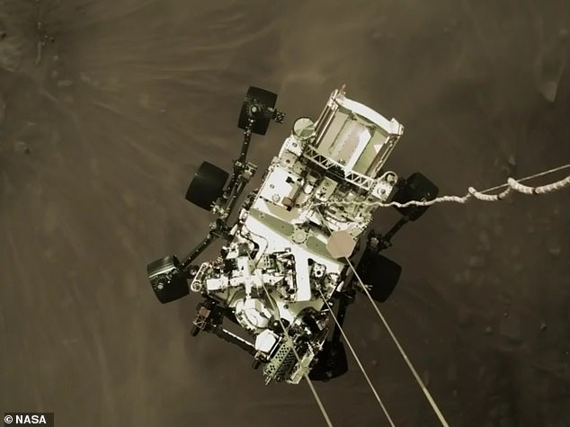 NASAshared an exciting image shot by the sky crane that shows Perseverance, nicknamed Perky, slung beneath and attached to mechanical bridals – moments before making landfall. NASA believes this image will become an iconic picture of spaceflight history