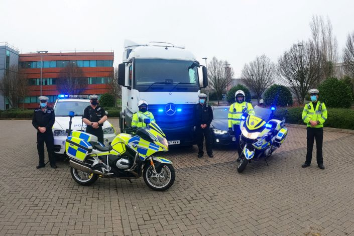 Avon and Somerset Police Operation Tramline team. See SWNS story SWBRears; The footage was captured during Operation Tramline - and shows the trucker on the M4 motorway in his 44 tonne articulated lorry. Avon and Somerset Police were using a large goods vehicle (LGV) - allowing roads policing officers to gain an elevated view. The officers can be seen pulling alongside the lorry driver, who quickly removes the phones from his ears to put both hands back on the steering wheel. The offending vehicle was then reported to a supporting policing unit which intercepted, indicated for it to pull over and dealt with offences. Chief Inspector Jason Shears, Roads Policing Lead for Avon and Somerset Police, said:
