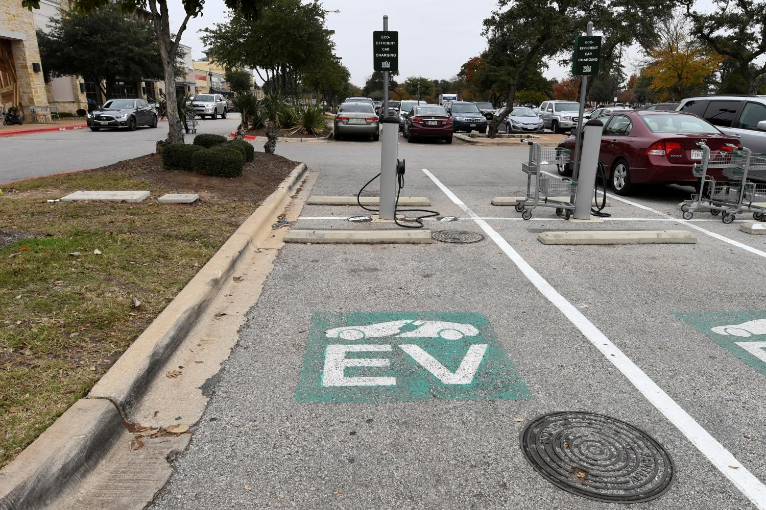 Drivers of electric vehicles who wish to take them on road trips need to plan ahead carefully. Here, a fast charging station in the parking lot of a Whole Foods Market in Austin, Texas.REUTERS