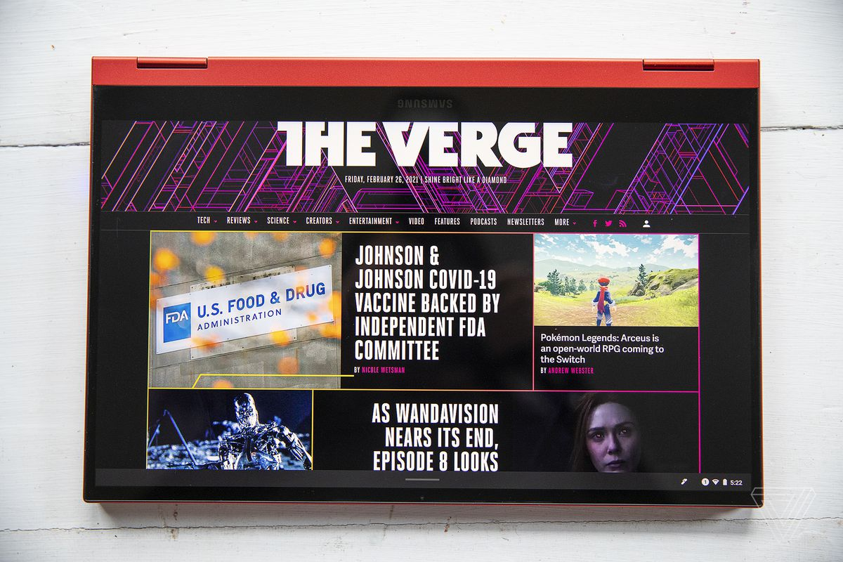 The Samsung Galaxy Chromebook 2 in tent mode with the screen facing the camera, displaying The Verge homepage.