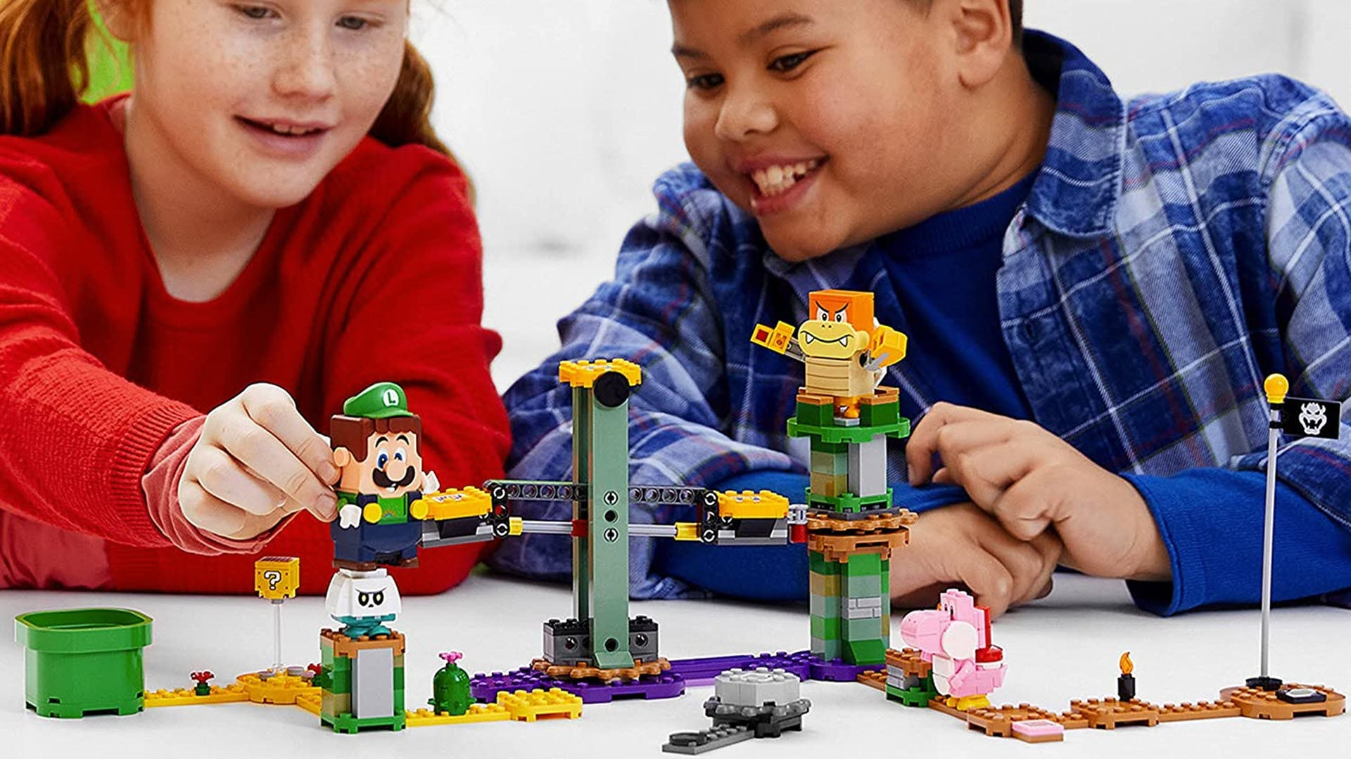 A LEGO Luigi course with Boom Boom, Pink Yoshi, and Bone Goomba