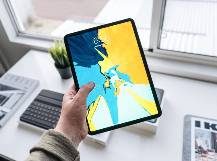 person holding ipad pro