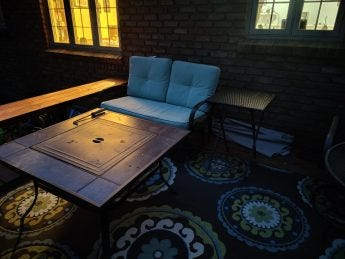 A photo of a patio at night.