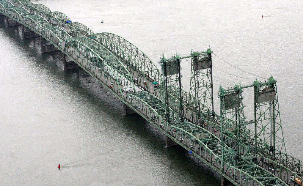 The dual I-5 bridges between Washington and Oregon would be replaced with a new Columbia River crossing, the biggest of several projects the Legislature hopes to fund with higher taxes on fuel and other transportation-related fees. Washington state's share might be around $1 billion. ( Rick Bowmer / The Associated Press, 2012)