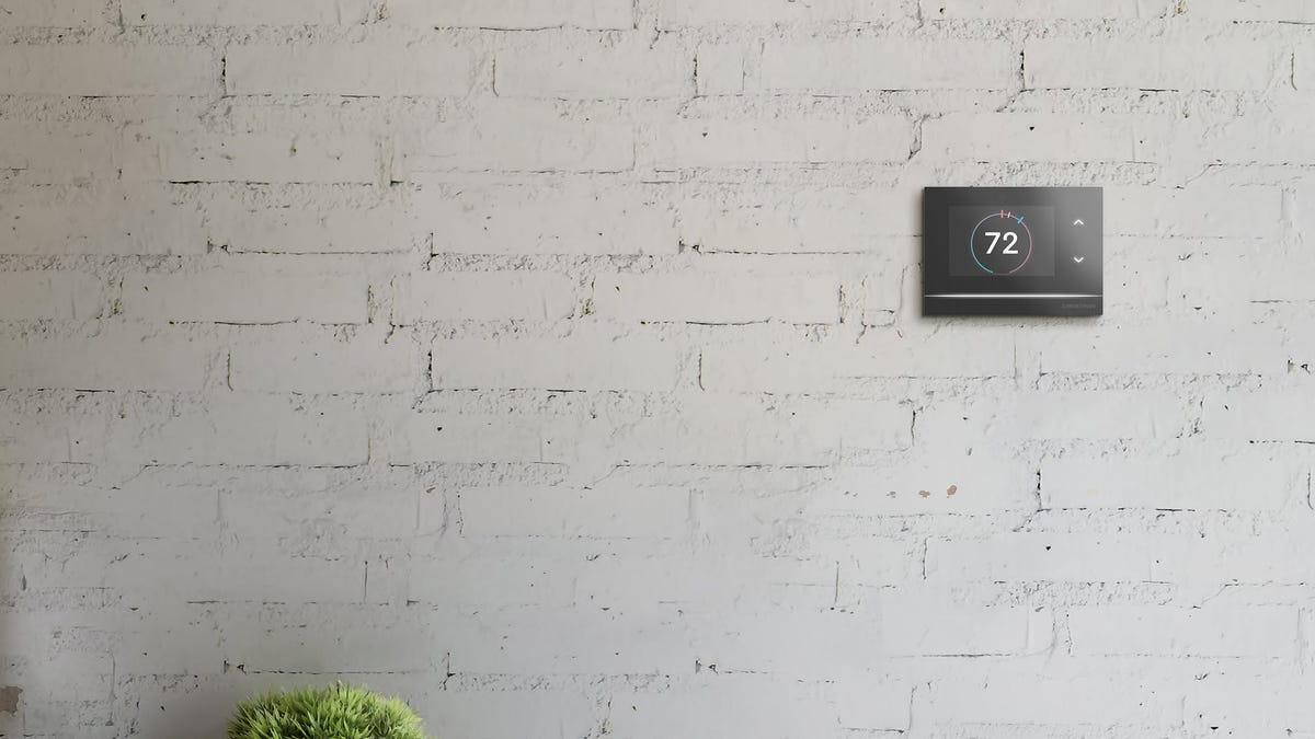 A Crestron Horizon thermostat on a brick wall