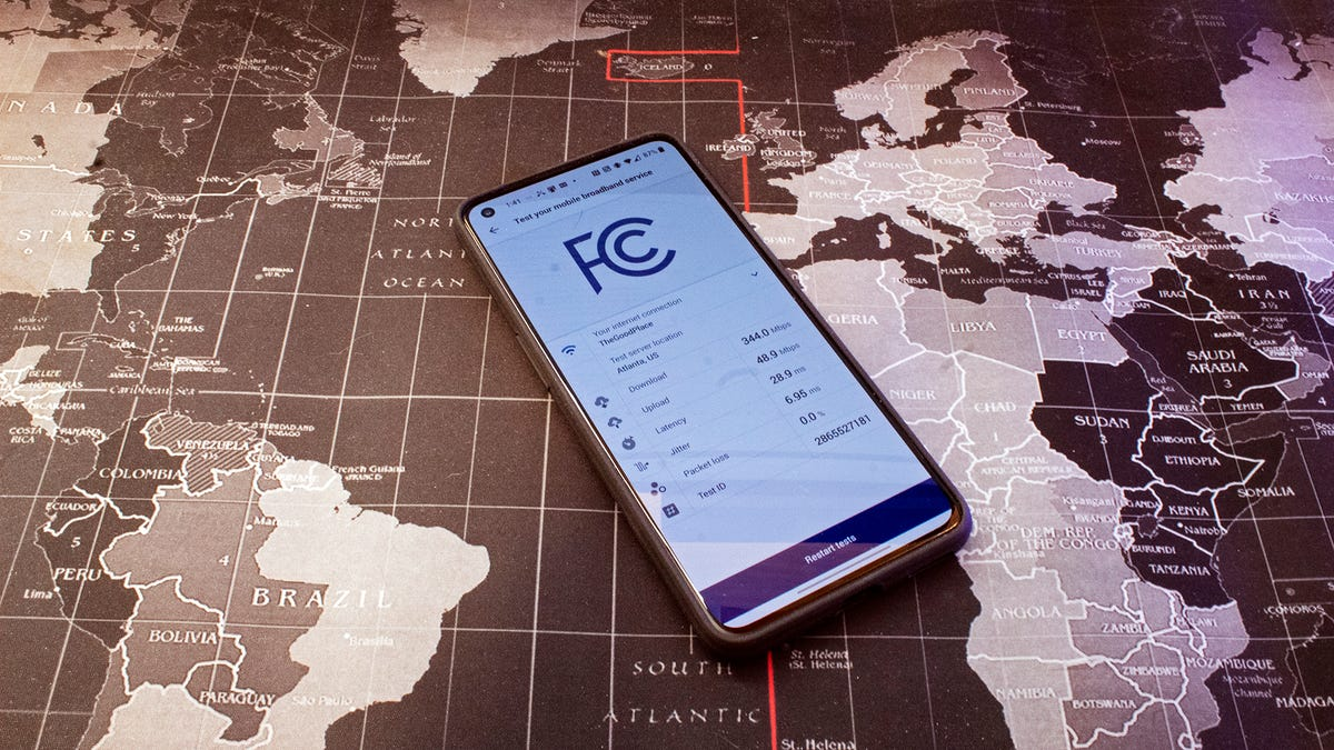 A OnePlus phone with the FCC Speed Test app open