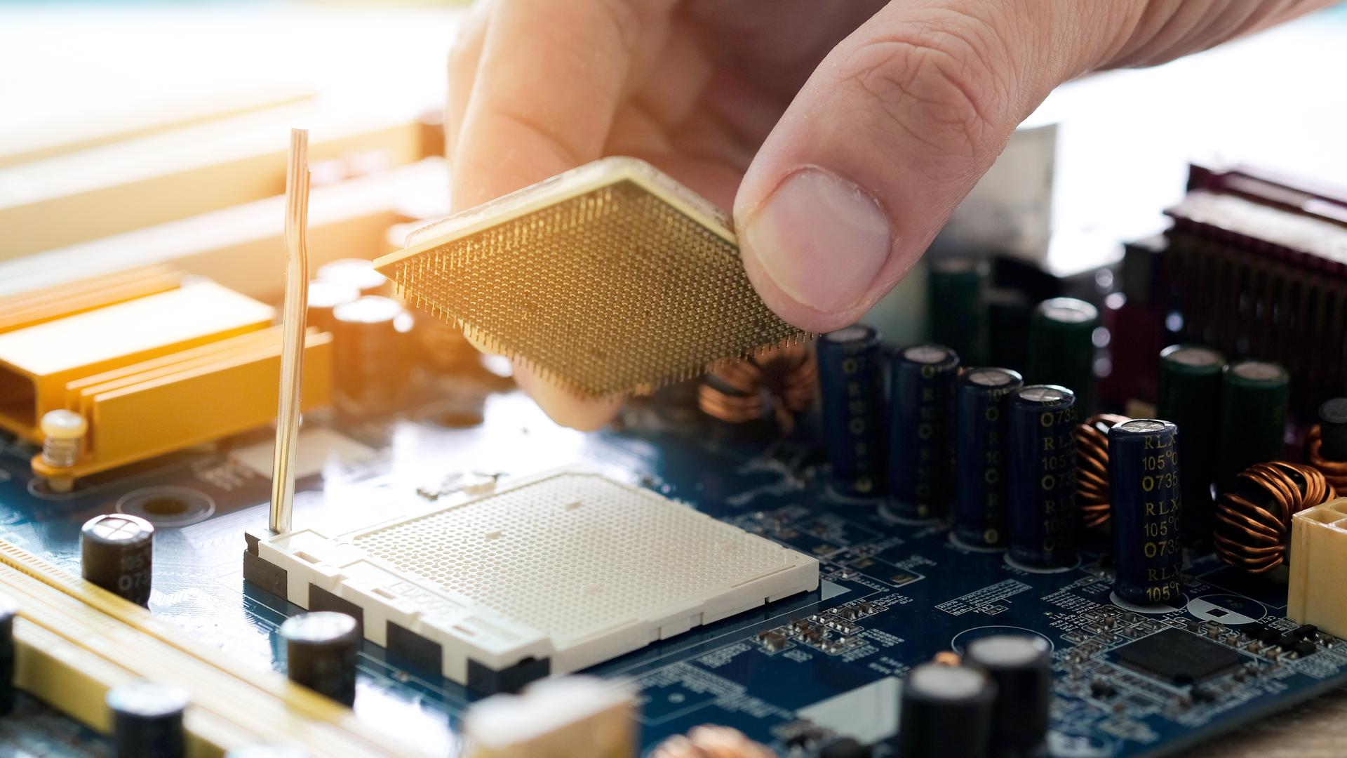 A person installing a CPU