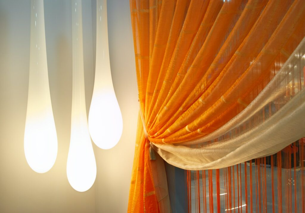 Room with curtains and lamp.