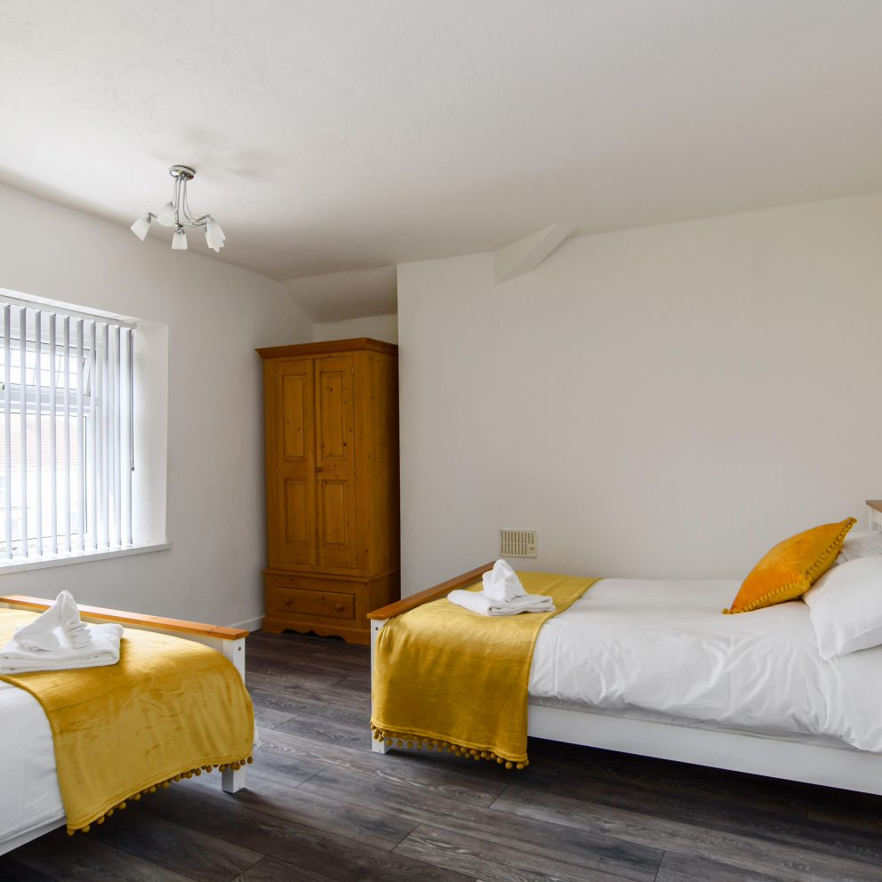Clarence Heights yellow bedroom