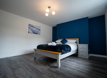 Clarence Retreat bedroom blue wall