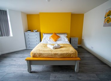 Clarence Retreat bedroom yellow wall