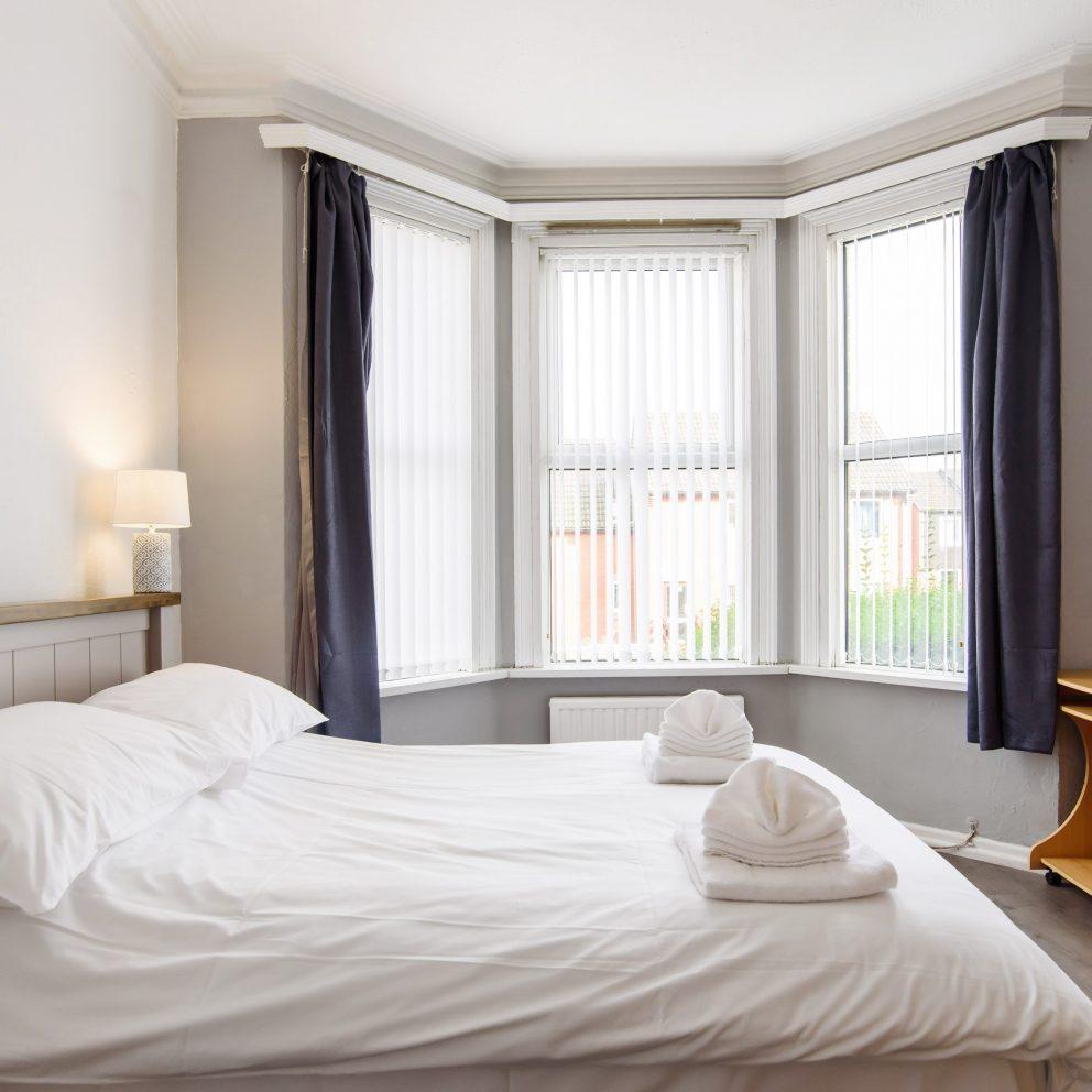 Handpost Lodge bedroom with view