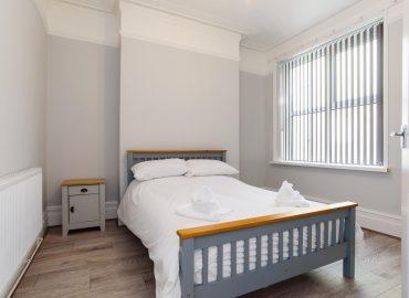 Handpost retreat bedroom