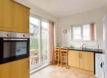 Handpost view kitchen and garden