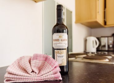 Handpost view bottle of wine