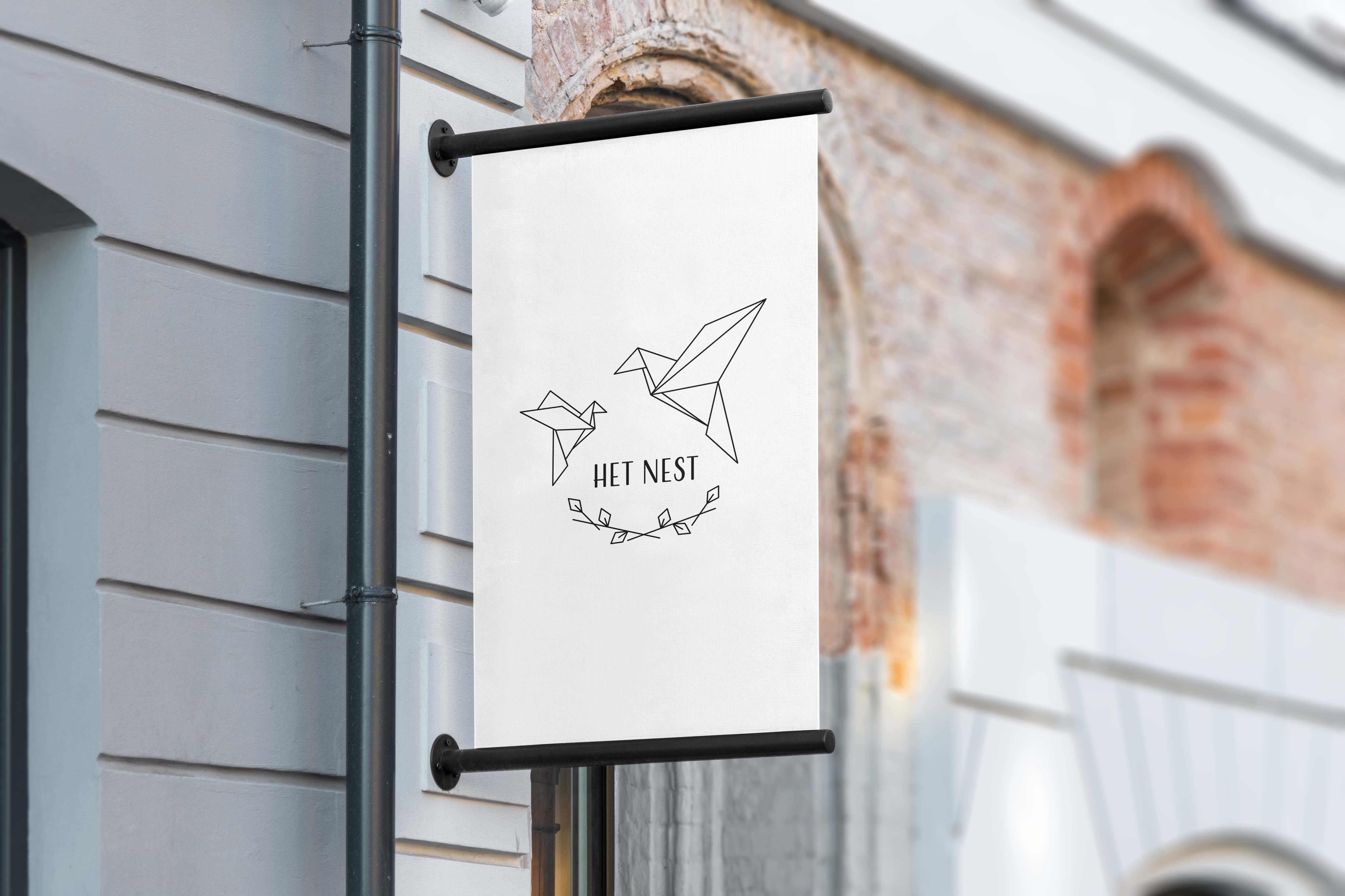 logo ontwerp het nest kinderdagverblijf