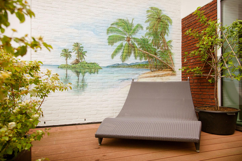Dakterras muurschildering buiten. Buitenmuur schildering airbrush.