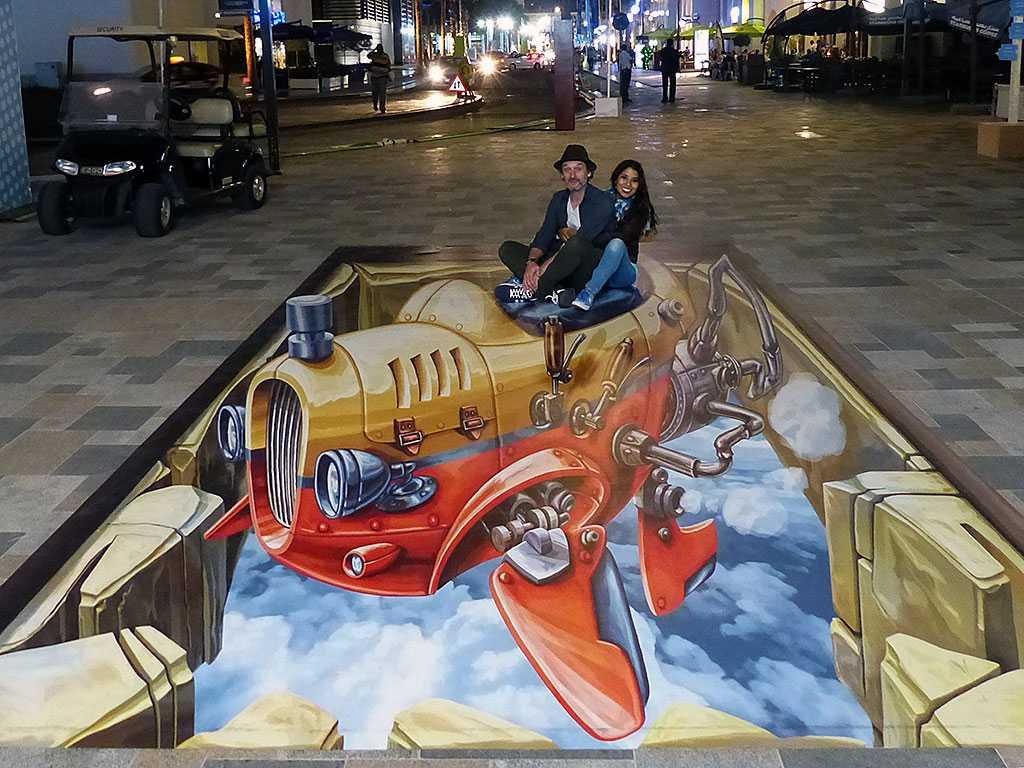3d-streetpainting-3d-flying-car-2-remko-van-schaik-3d-streetart-festival-dubai-canvas-2016-4
