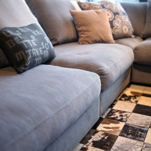 Canva - Comfortable grey couch with pillows