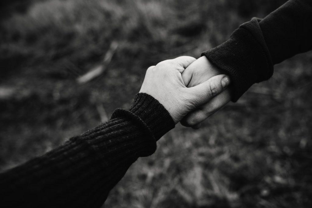 Compassion meditation, holding hands - Kat Jayne, Pexels