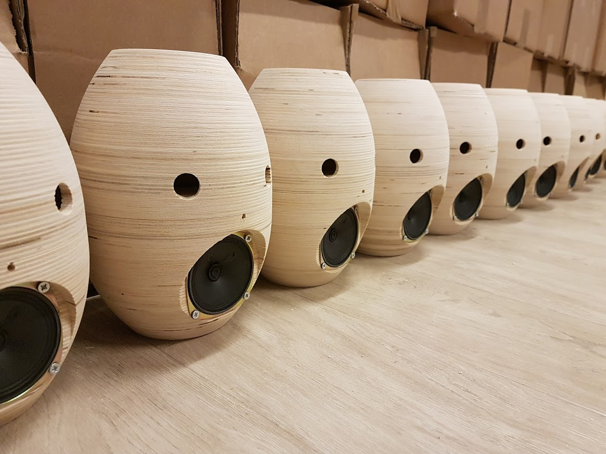The Tessa robot, during assembly. Several wooden embodiments stand side-by-side.