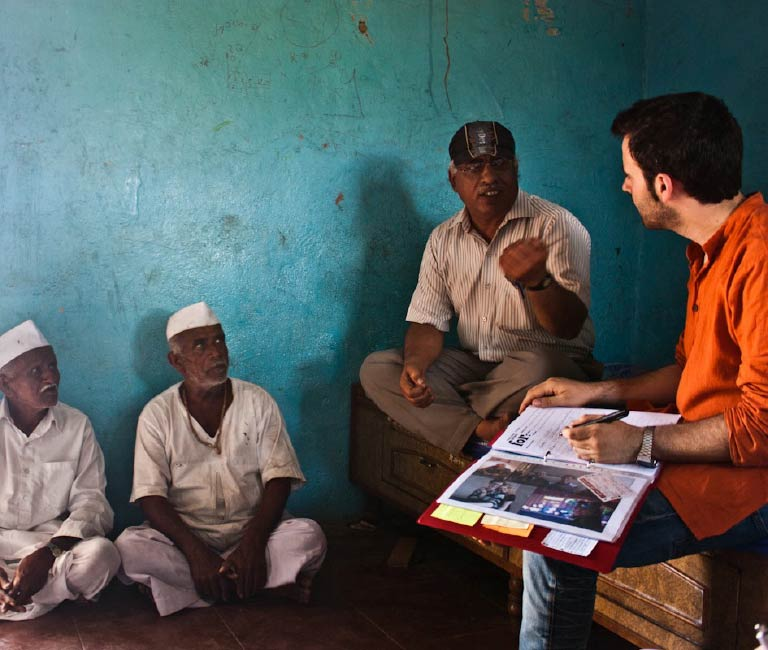 Photo of an interview, taken place in rural India.
