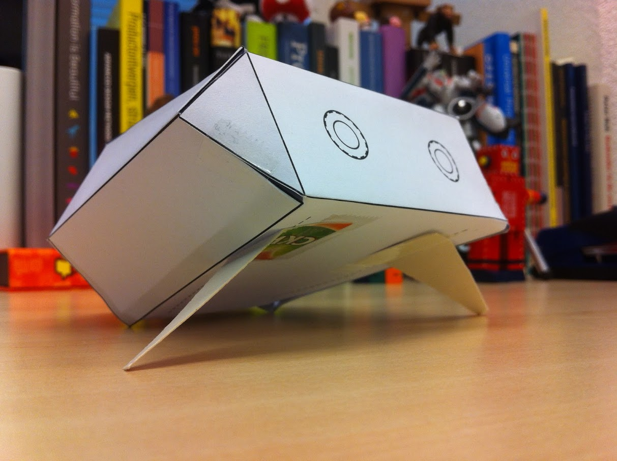 A paper prototype of Polygon on a desk